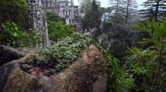 Quinta da Regaleira palace estate in the clouds, tilt up, Sintra, Portugal Stock Footage