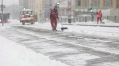 Stock Video Footage of Squad of city workers cleaning snow from station