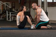 Couple Doing Sit-Ups Abdominal Crunch - stock photo