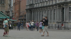 People walking and taking pictures in Burg, near the Bishop's palace, Bruges Stock Footage
