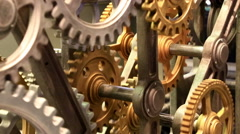 Moving gears of old mechanism close up - stock footage