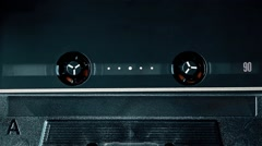 Black metal top grade audio cassette spinning, clean close-up Stock Footage