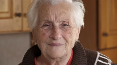 portrait of a quiet and happy old woman - stock footage