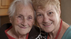 grey haired old woman and  her niece, embrace, legacy - stock footage