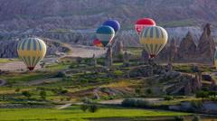 Passenger balloons floating over Cappadocia, Turkey Stock Footage