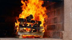 Hot Fireplace Full of Wood and Fire Stock Footage