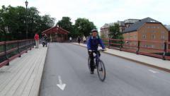 People walk by the bridge in Trondheim, Norway. Stock Footage