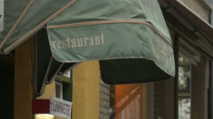 Green awning of 't Lammetje restaurant on Braambergstraat, Bruges Stock Footage