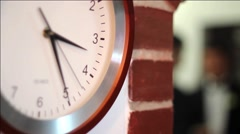 Wall clock marks time until the group of revelers will have to go to the party - stock footage
