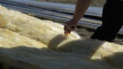 Stock Video Footage of Piece of mineral wool is cut with a cutter in appropriately sized pieces 4c
