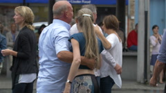 View of couples dancing and talking in Vismarkt, Bruges Stock Footage