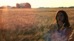Country Girl In Wheat Field At Sunset Stock Footage