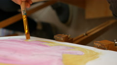Artist paints picture artwork canvas in art studio - stock footage