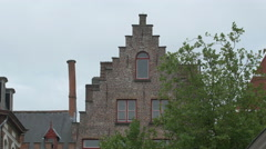 View of an old building with step gable roof in Bruges - stock footage