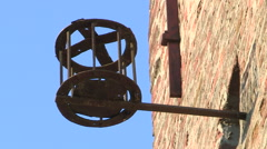 An old metal basket placed on the wall of a tower Stock Footage