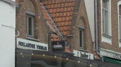 View of Hollandse Vismijn and Jupiter bars signs in Bruges Stock Footage