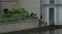 Bronze sculpture in the grass, Bruges Stock Footage