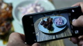 Take a picture of food via phone - healthy salad on plate with grilled meat ribs Footage