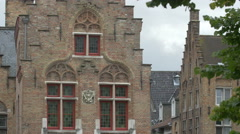 Beautiful old buildings with step gable roof in Bruges - stock footage