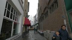 People walking on Geernaarstraat, near De Carre Restaurant, Bruges Stock Footage