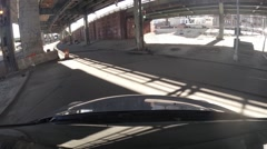 The car goes on the road under the railway tracks Stock Footage