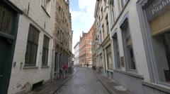 People walking on Wapenmakersstraat street, Bruges Stock Footage