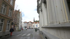 Walking next to a Lotto Office in Sint-Jansplein square in Bruges Stock Footage