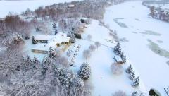 Beautiful riverfront homes buried under fresh blizzard snow Stock Footage
