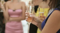 Group of models drinking champagne from glasses at a party Stock Footage