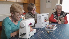 Two generations of skilled seamstress working together Stock Footage