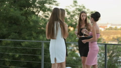 Women in evening dresses drinking champagne and talking Stock Footage