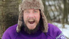 Emotional bearded man looking into the camera, swearing, smoking, laughing. - stock footage