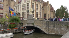 Boat floating under a bridge in Bruges Stock Footage