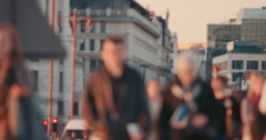 Anonymous crowd of people walking  commuters London City street slow motion Arkistovideo