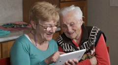women try use a tablet, adult learning, grey hair - stock footage