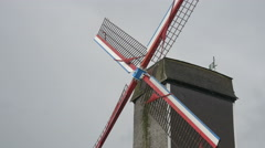 Sint-Janshuismolen windmill seen on a rainy day in Bruges Stock Footage