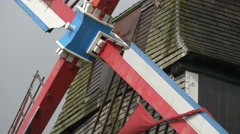 View of Sint-Janshuismolen windmill's colorful blades in Bruges Stock Footage