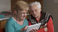 curious old woman trying to learn how to use an app - stock footage