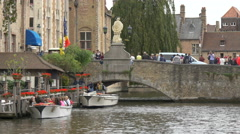 Small boat leaving the waterfront in Dijver Canal, Bruges Stock Footage