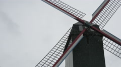 View of Sint-Janshuismolen windmill seen on a rainy day in Bruges Stock Footage