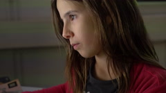 Young girl using computer at in dark room 4k Stock Footage