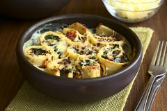 Baked Crepe Rolls Casserole - stock photo