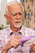 Senior Man Reading Instructions On Medication Stock Photos