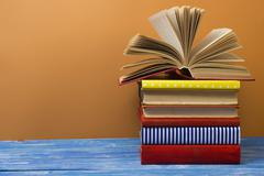 Open book, hardback books on wooden table. Back to school. Copy space for text - stock photo