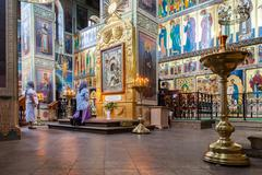 Orthodox Christians inside the Assumption Cathedral Stock Photos