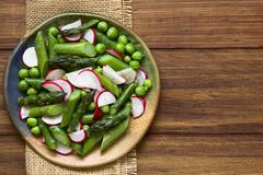 Green Asparagus Radish and Pea Salad - stock photo
