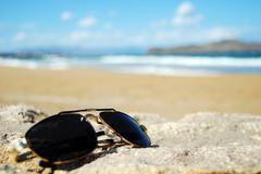 Shades on beach Stock Photos