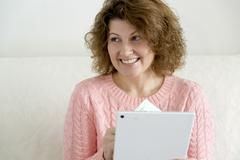 Woman with tablet pc computer and credit card, money at home Stock Photos