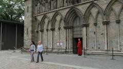 People exit from the Nidaros cathedral in Trondheim, Norway. Stock Footage