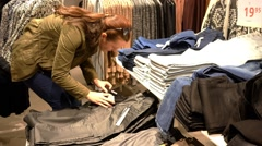 Woman Choosing Clothes  During Shopping Stock Footage